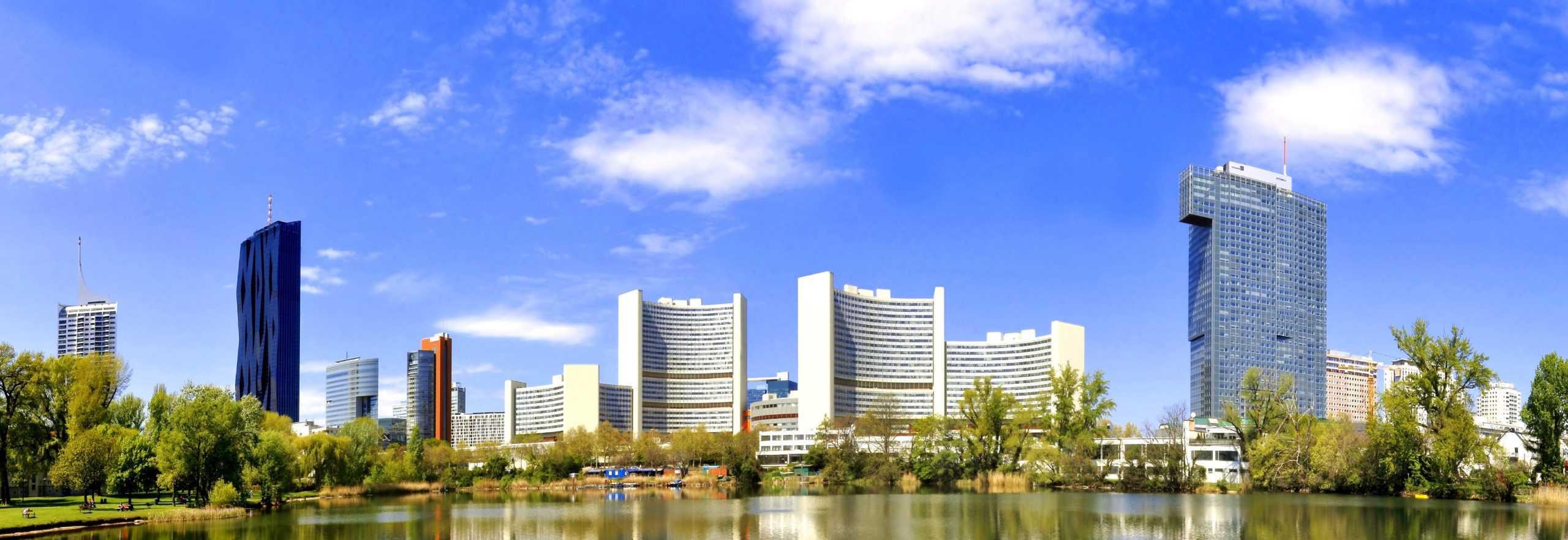 04/24/2018 Vienna, Austria Panorama of UNO-City at Lake Alte Donau and blue sky